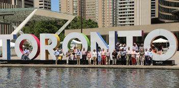 group photo at TORONTO sign