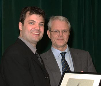 James Rutka (NeurSurg) (right) presents the Donald R. Wilson Award to Melfort Boulton (NeurSurg Resident)
