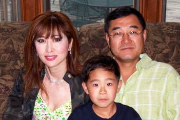 Peter Kim with his wife Jennifer and son William